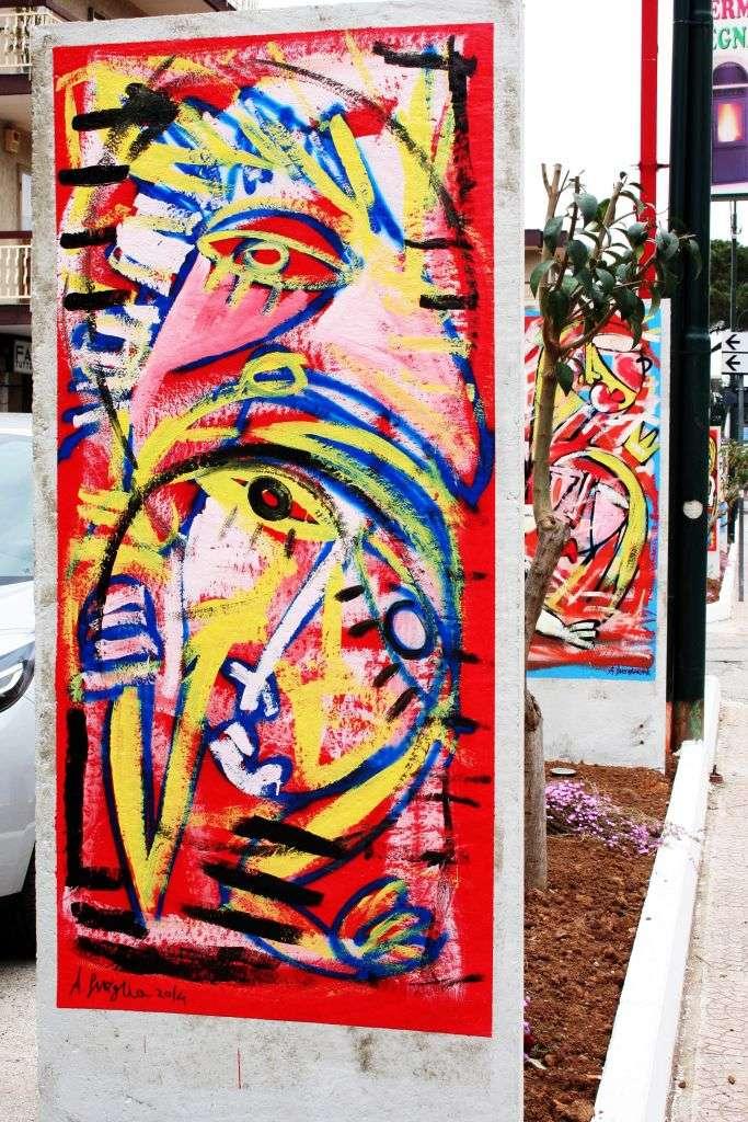 murales con rosso giallo , figure umane e astratte decorazione urbana